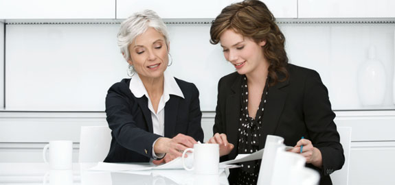 Women reviewing business documents