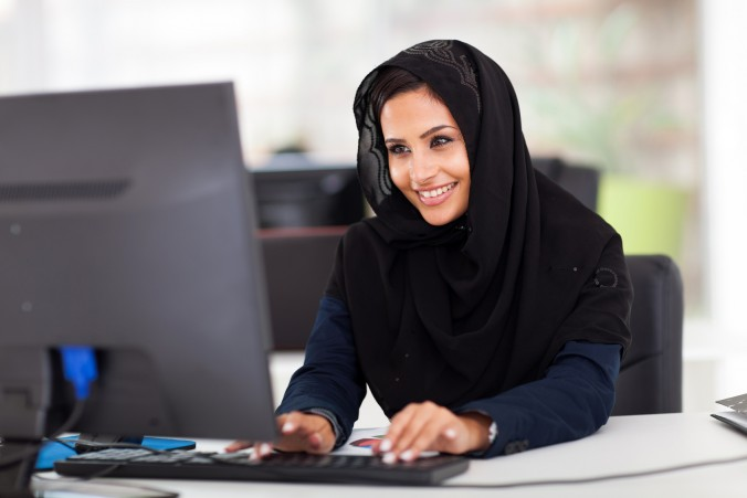 Woman working at her computer