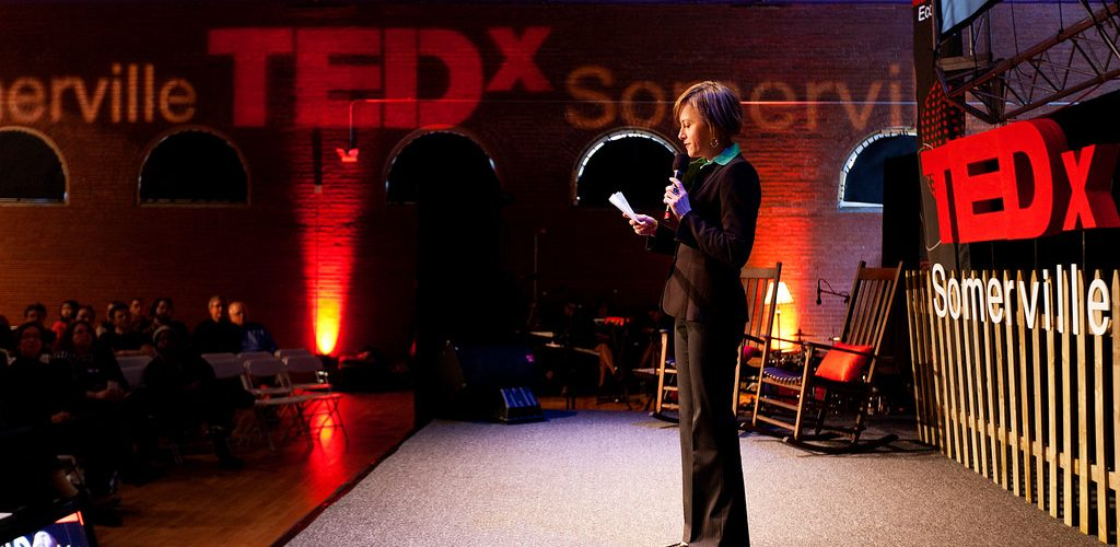 Woman giving a TED talk